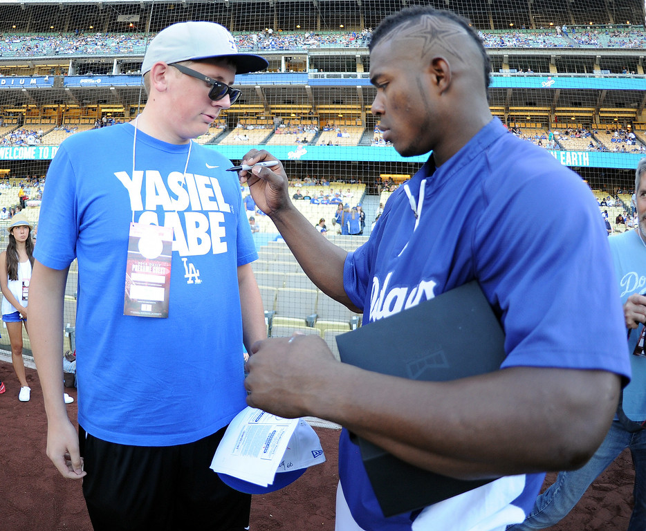 . Los Angeles Dodgers\' Yasiel Puig signs Graham Fagerquist shirt prior to a Major league baseball game between the San Diego Padres and the Los Angeles Dodgers on Saturday, July 12, 2014 in Los Angeles.   (Keith Birmingham/Pasadena Star-News)