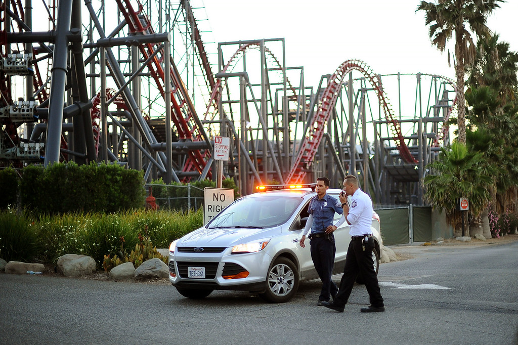 . Members of the Six Flags Magic Mountain security staff monitor the situation at the exit of the park after riders were injured on the Ninja ride July 7, 2014 in Valencia.(Andy Holzman/Los Angeles Daily News)