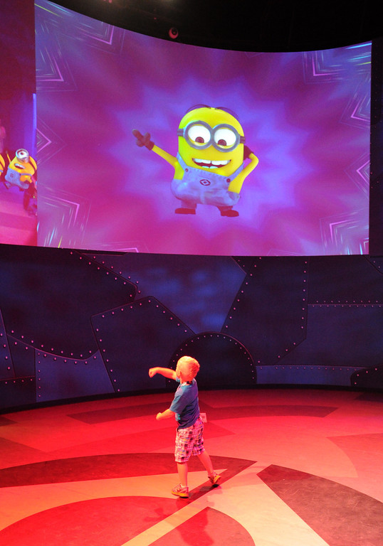 . After the ride, a child dances in front of an interactive screen. Universal Studios Hollywood will soon open the Despicable Me Minion Mayhem and Super Silly Fun Land. Universal City,CA. March 20, 2014 (Photo by John McCoy / Los Angeles Daily News)