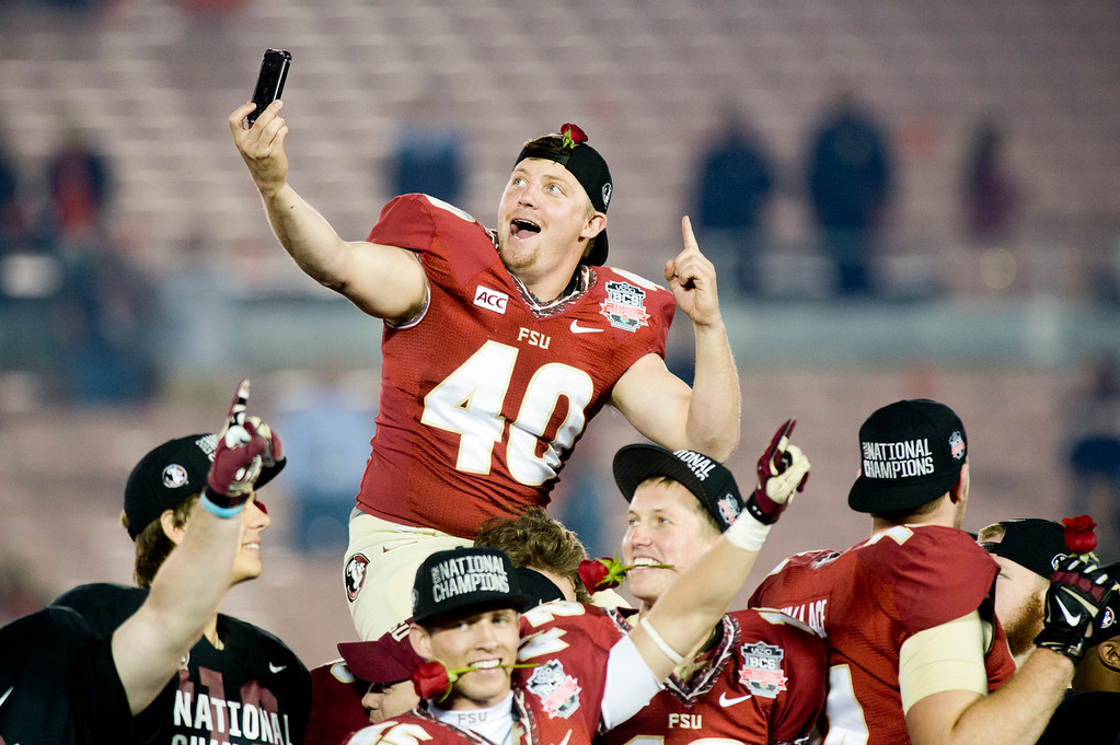. Parker Conley (40) of Florida States takes a selfie during the celebration over Auburn in the BCS National Championship game at the Rose Bowl in Pasadena Calif. on Monday, Jan. 6, 2014. (Watchara Phomicinda/ Pasadena Star-News)
