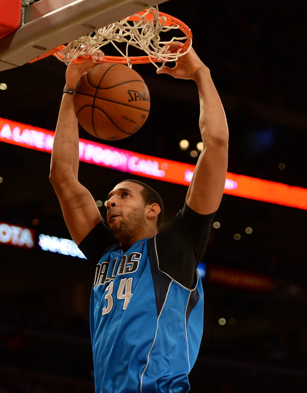 . Dallas Mavericks forward Brandan Wright slam dunks in the second half during an NBA basketball game against the Los Angeles Lakers in Los Angeles, Calif., on Friday, April 4, 2014. Dallas Mavericks won 107-95.  (Keith Birmingham Pasadena Star-News)