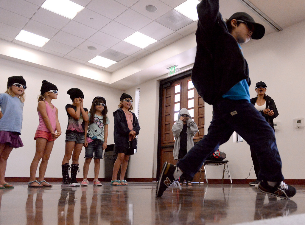 . Julian Castro, 6, shows his hip-hop dance moves as he takes center stage during a dance showcase at the San Dimas Library Summer Reading Program June 26, 2013.  (Thomas R. Cordova/Staff Photographer)