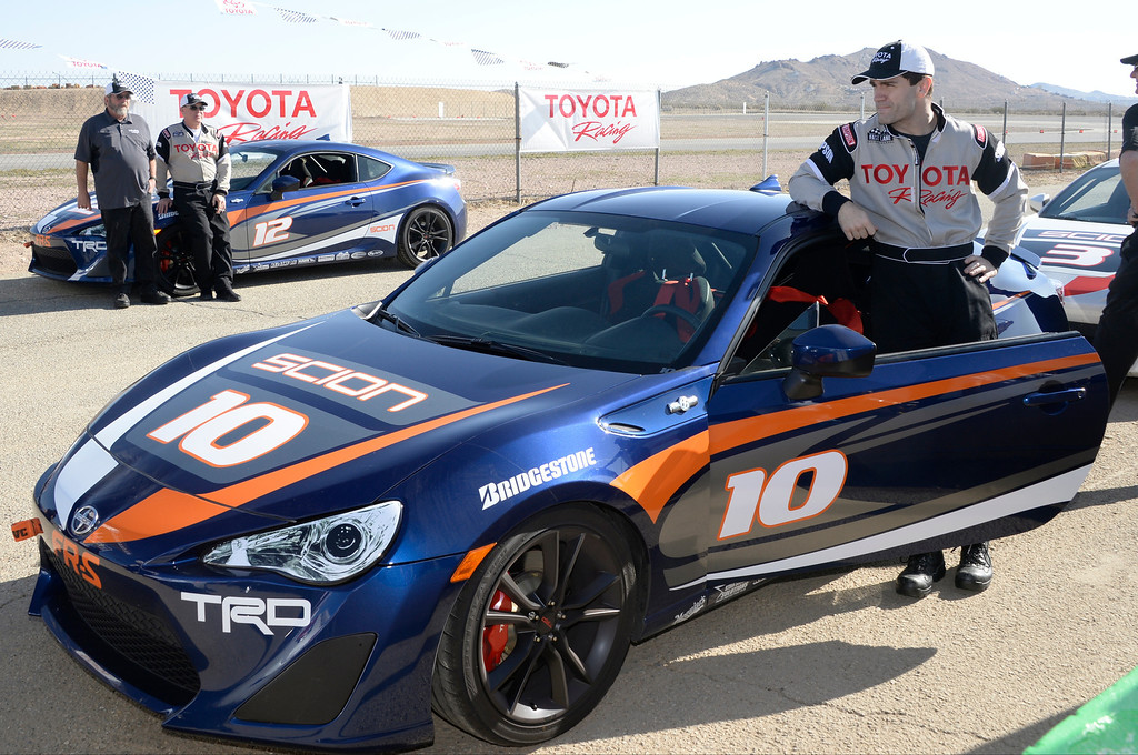 . March 15,2014. Rosamond CA. Actor Sam Witwer poses with his #10 car, as celebrities in the Long Beach Grand Prix practice racing with instructors in Toyota race cars at the Willow Springs International Raceway.  photo by Gene Blevins/LA DailyNews