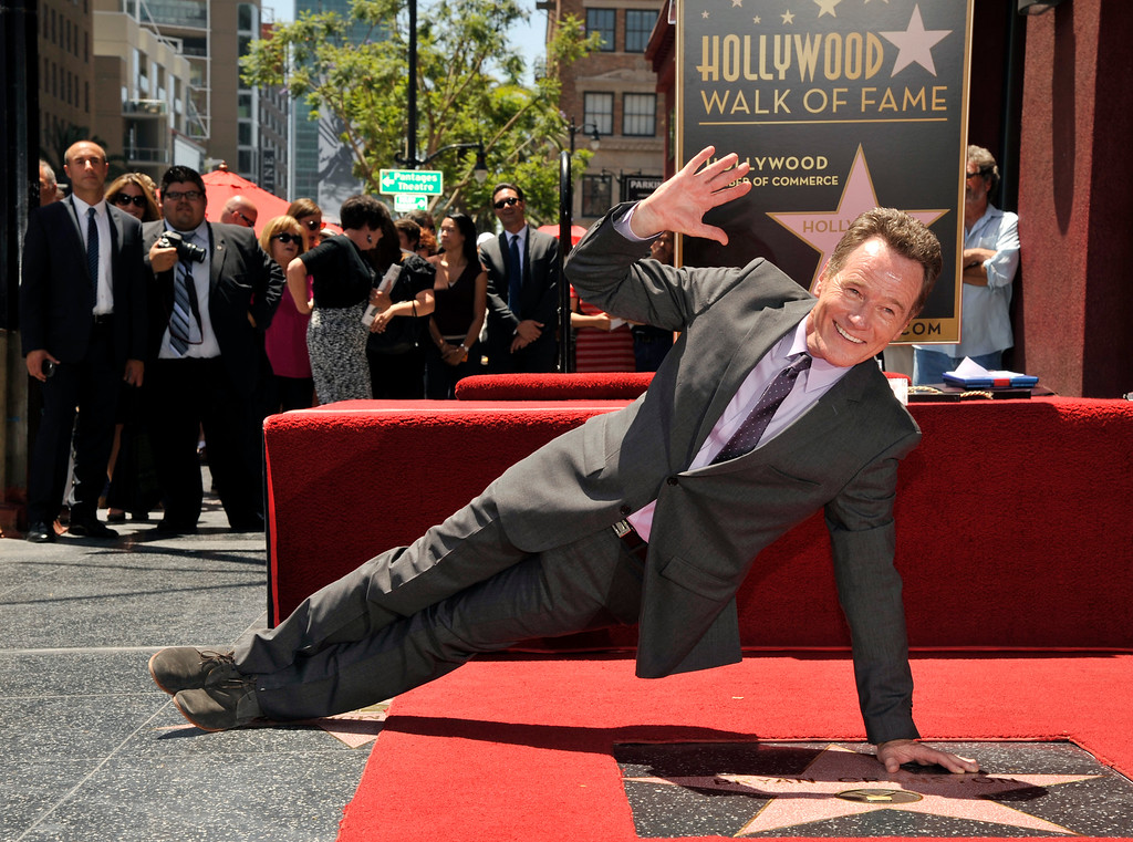 . Bryan Cranston waves to photographers as he performs a one-armed push-up atop his new star on the Hollywood Walk of Fame on Tuesday, July 16, 2013 in Los Angeles. (Photo by Chris Pizzello/Invision/AP)