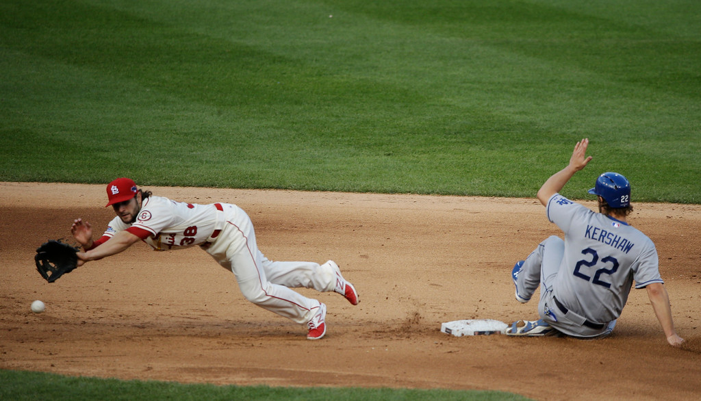 . St. Louis Cardinals\' Pete Kozma can\'t come up with a throw from teammate Matt Carpenter as Los Angeles Dodgers\' Clayton Kershaw (22) slides safely into second during the sixth inning of Game 2 of the National League baseball championship series Saturday, Oct. 12, 2013, in St. Louis. (AP Photo/Charlie Neibergall)