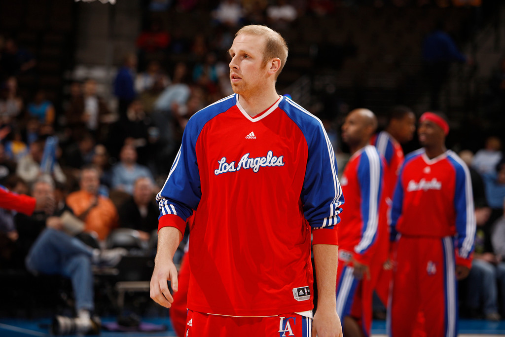 . Los Angeles Clippers center Chris Kaman warms up before facing the Denver Nuggets in the first quarter of an NBA basketball game in Denver on Thursday, Jan. 21, 2010. (AP Photo/David Zalubowski)