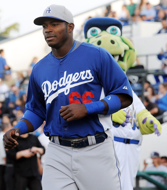 . Dodgers outfielder Yasiel Puig, who defected from Cuba last year, led the major leagues in batting average in spring training this spring. (Will Lester/Staff Photographer)