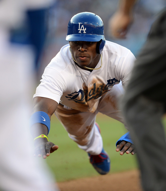 . The Dodgers\' Yasiel Puig #66 dives back to 1st base during their game against the Reds at Dodger Stadium in Los Angeles Saturday, July 27, 2013. (Hans Gutknecht/Los Angeles Daily News)