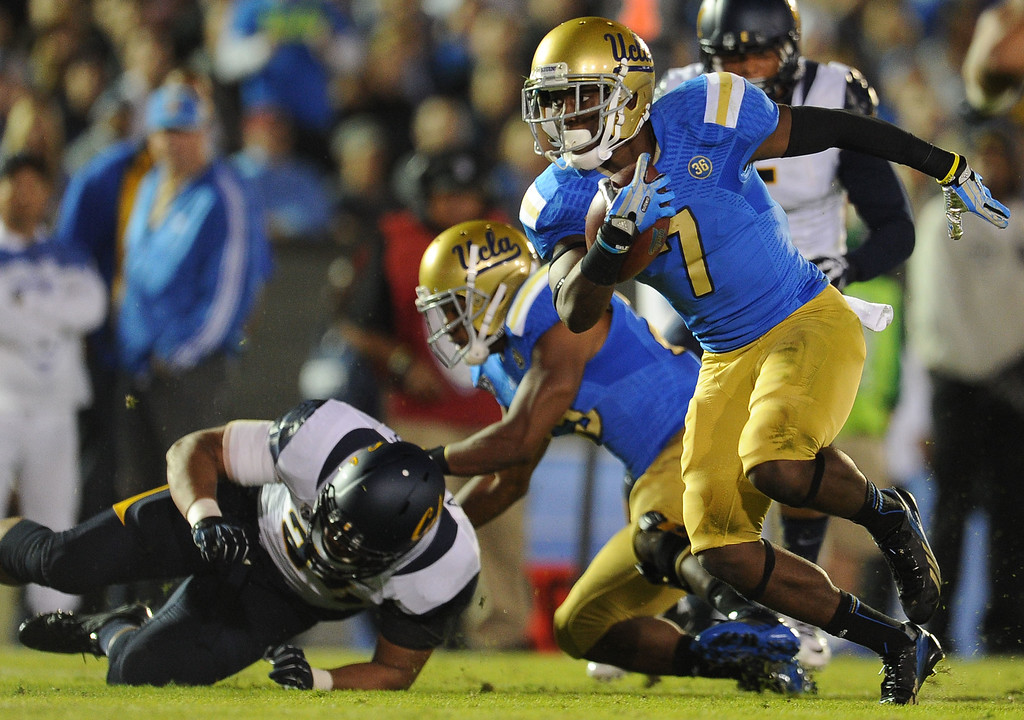 . UCLA wide receiver Devin Fuller (7) runs past the block after catching a pass for a first down against California during the first half of their college football game in the Rose Bowl in Pasadena, Calif., on Saturday, Oct. 12, 2013.   (Keith Birmingham Pasadena Star-News)