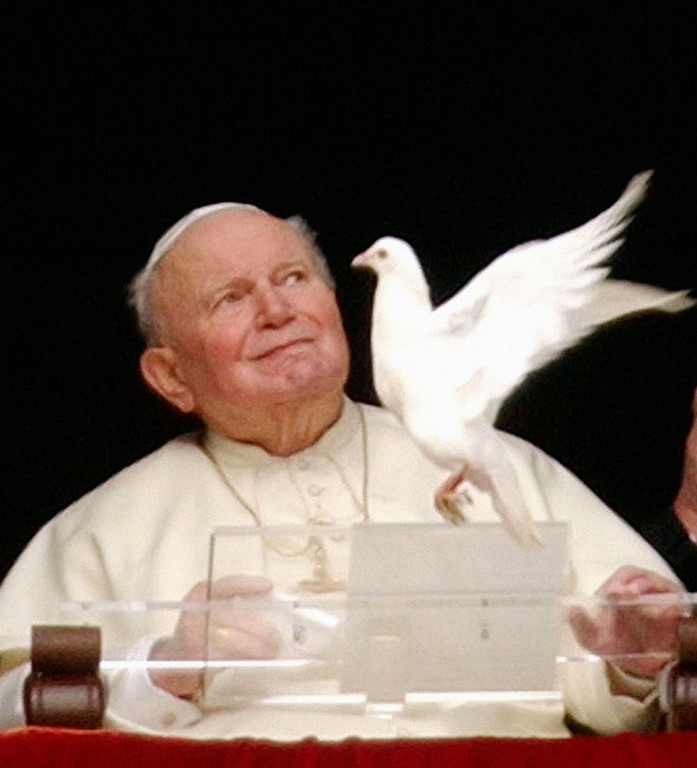 . ** FILE ** Pope John Paul II looks at white doves that were freed at the end of the Angelus prayer in St. Peter\'s square, at the Vatican, Jan. 30, 2005. Italian news agencies ANSA and Apcom said Thursday Feb. 24, 2005 that the doctors were considering performing a tracheotomy _ a procedure in which a hole is made in the throat and a tube is inserted to assist breathing. The Vatican and hospital spokesman Nicola Cerbino refused to comment on the reports. (AP Photo/Plinio Lepri)