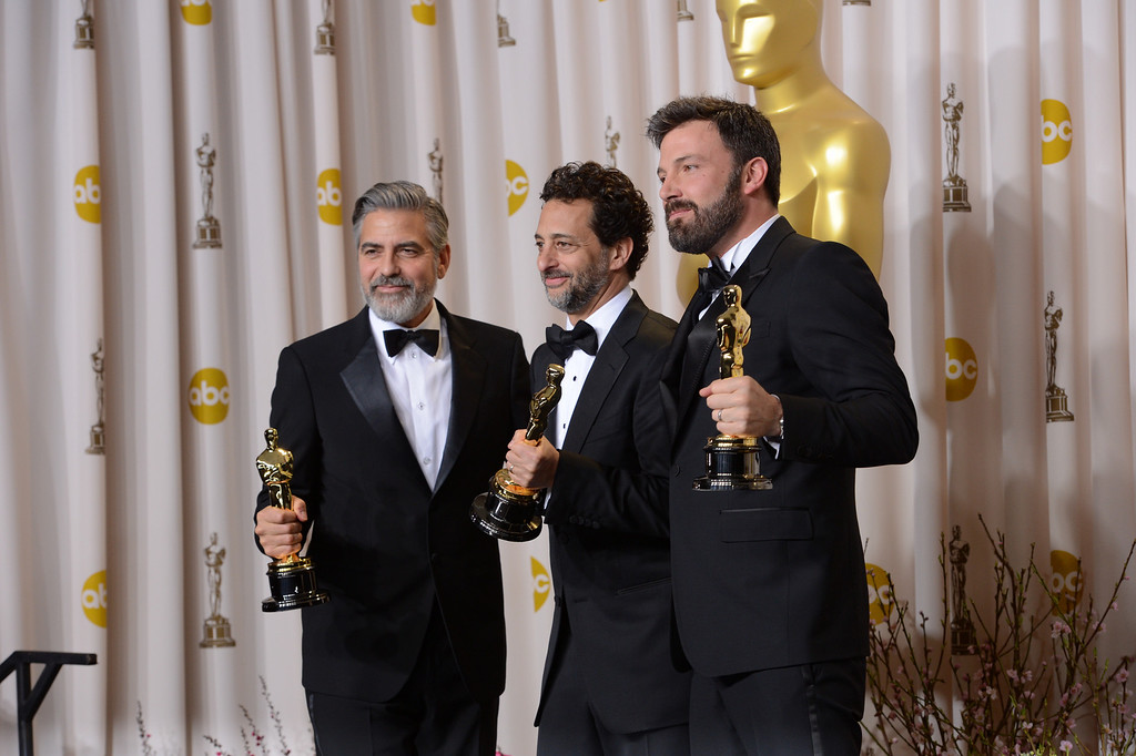 """. George Clooney, Grant Heslov, and Ben Affleck, accepts the award for best picture for \""""Argo\""""  backstage at the 85th Academy Awards at the Dolby Theatre in Los Angeles, California on Sunday Feb. 24, 2013 ( David Crane, L.A. Daily News)"""