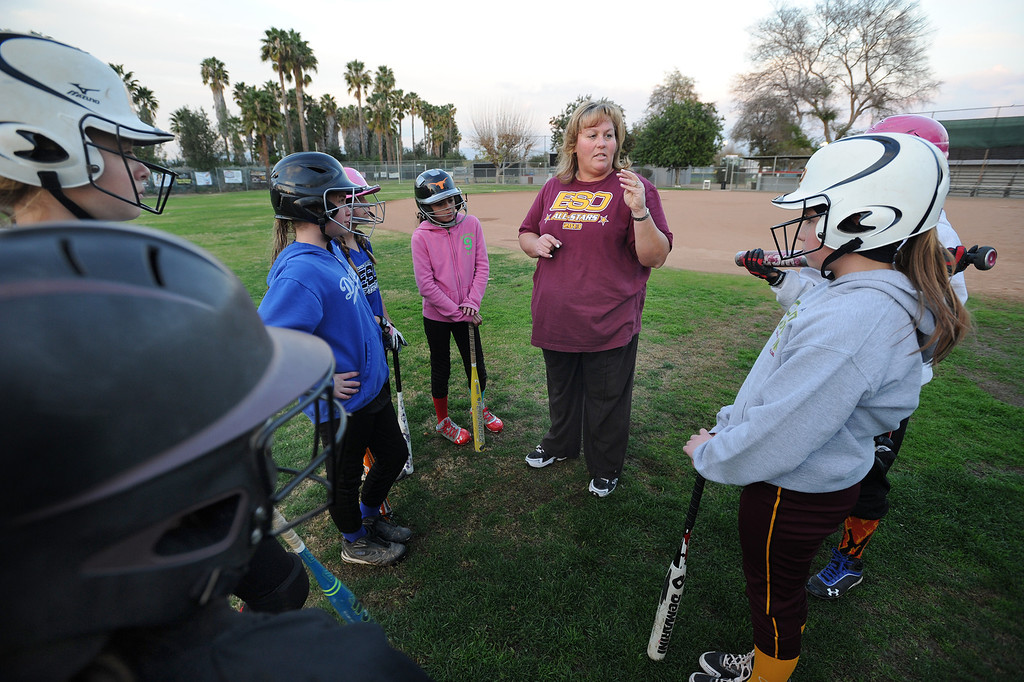 . Coach Delanee Durham talks with her team before practice. A dispute has erupted between the nonprofit Encino-Sherman Oaks Softball � a four-year-old, award-winning fast-pitch league serving girls--and Mid-Valley Boys Baseball, which operates at the same complex at 17301  Oxnard St. Encino CA. February 5, 2014 (Photo by John McCoy / Los Angeles Daily News)