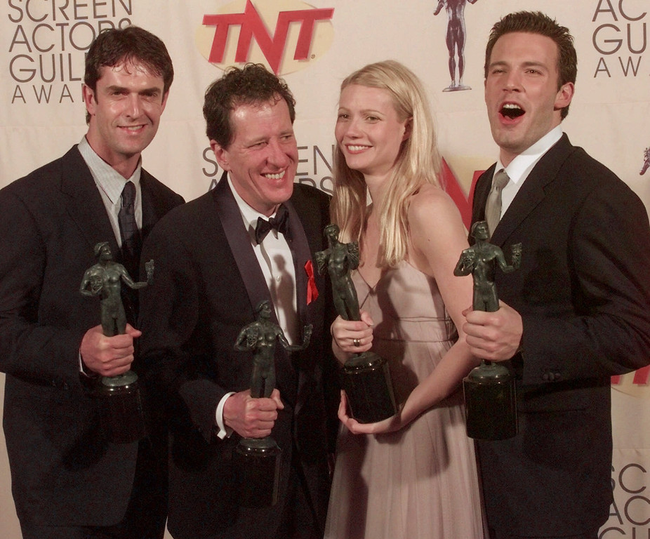 """. \""""Shakespeare in Love,\"""" cast members, from left, Rupert Everett, Geoffrey Rush, Gwyneth Paltrow and Ben Affleck display their awards for outstanding performance in a theatrical motion picture at the 5th Annual Screen Actors Guild Awards in Los Angeles, Calif., Sunday, March 7, 1999. (AP Photo/Reed Saxon)"""
