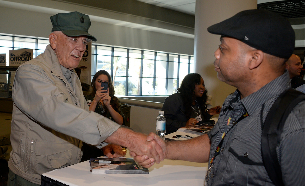 . Nov 6,2013 Las Vegas NV. USA.  Actor Ronald Lee Ermey best known for his role as Gunnery Sergeant Hartman in Full Metal Jacket, signs signs autographs at the Off road success center during the second day of the 2013 SEMA auto show.