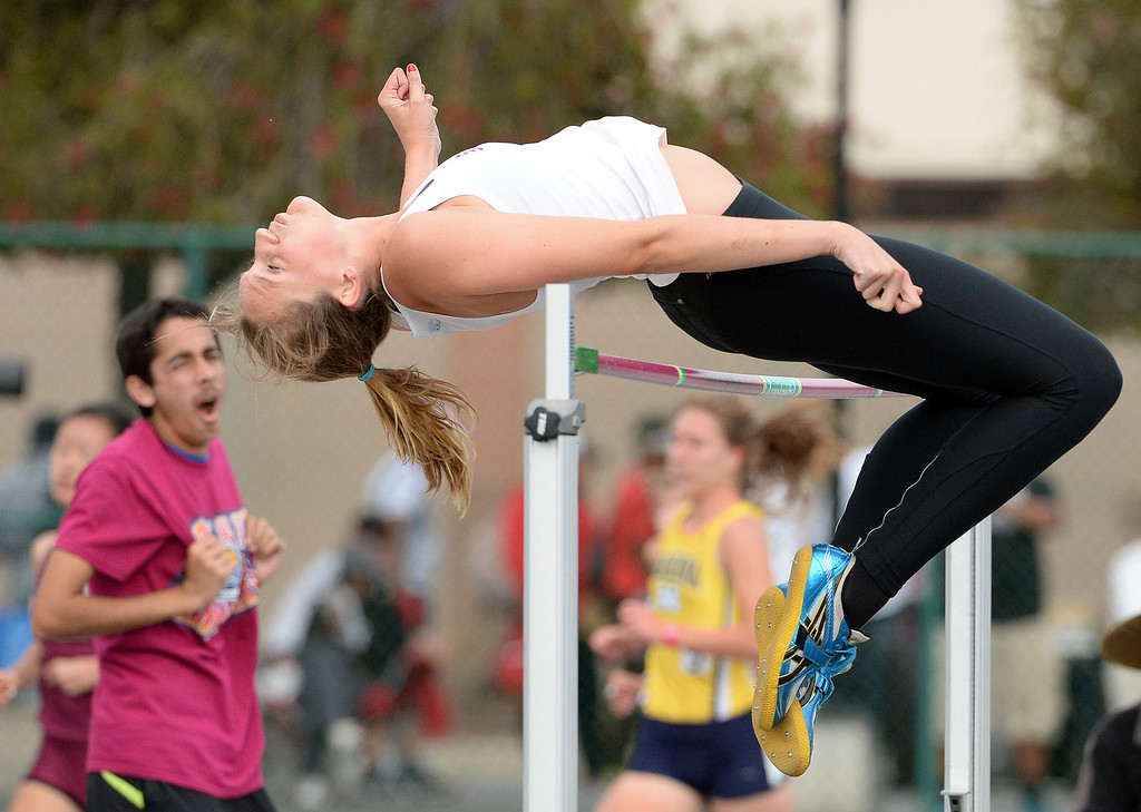 . Glendora\'s Sidney Pink competes in the division 2 high jump during the CIF Southern Section track and final Championships at Cerritos College in Norwalk, Calif., on Saturday, May 24, 2014. 