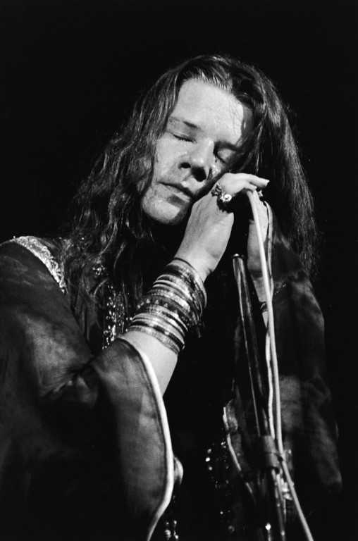 . American singer Janis Joplin (1943 - 1970) closes her eyes and cradles a microphone while performing, c. 1967. (Photo by Tucker Ransom/Getty Images)