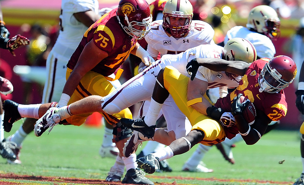 . Southern California running back Justin Davis (22) runs for a first down against Boston College during the first half of an NCAA college football game in the Los Angeles Memorial Coliseum in Los Angeles, on Saturday, Sept. 14, 2013.  (Photo by Keith Birmingham/Pasadena Star-News)