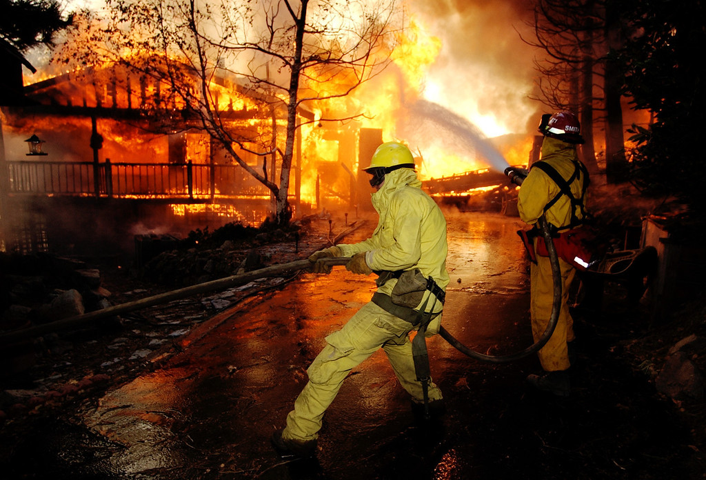 . Ten years ago this month the arson caused Old Fire, fanned by Santa Ana winds burned thousands of acres, destroyed hundreds of homes and caused six deaths. The fire burned homes in San Bernardino, Highland, Cedar Glen, Crestline, Running Springs and Lake Arrowhead and forced the evacuation of thousand of residents. (Staff file photo/The Sun)