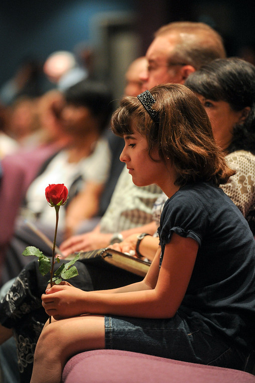 . Sarah Clemans, 10, holds a rose during a prayer vigil at West Valley Christian School, Thursday, July 11, 2013, in honor of the crash victims of Asiana Flight 214 airliner that crashed at San Francisco Airport. (Michael Owen Baker/L.A. Daily News)