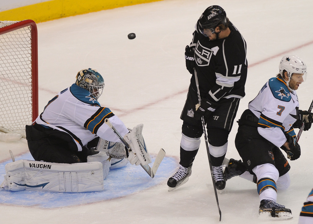 . The puck bounces between the Kings\' Anze Kopitar and Sharks\' goalie Antti Niemi in game two of the second round of playoffs, Thursday, May 16, 2013, at Staples Center. (Michael Owen Baker/Staff Photographer)