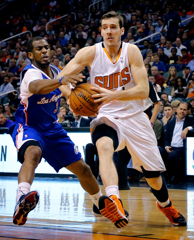 . Phoenix Suns guard Goran Dragic, right, of Slovenia, drives past Los Angeles Clippers guard Chris Paul (3) during the second half of an NBA basketball game, Wednesday, April 2, 2014, in Phoenix. The Clippers won 112-108. (AP Photo/Matt York)