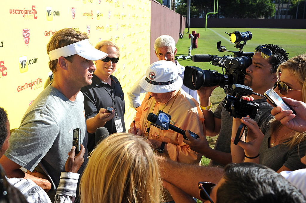 . USC head coach Lane Kiffin fields questions from the media following practice August 20, 2013.(Andy Holzman/Los Angeles Daily News)