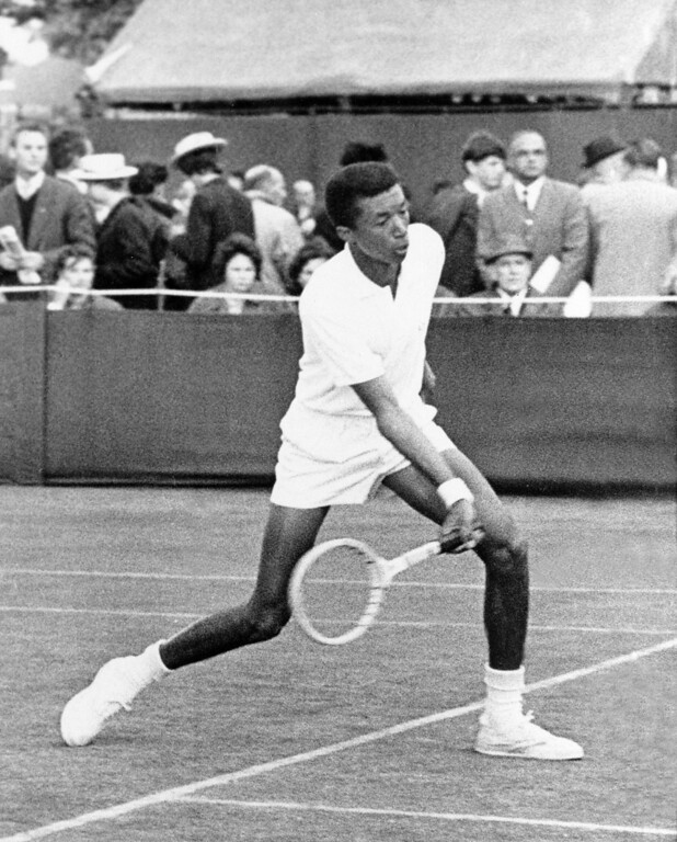 . Arthur Robert Ashe, 19, son of a Richmond, Va., policeman and the first African American ever to play in the Wimbledon, England tennis championships, makes a return during match with Australia\'s J.B. Hillebrand during the second round of the championships, June 26, 1963. Ashe defeated Hillebrand, 5-7, 7-5, 11-9, 3-6, 6-3.  Ashe is a junior at UCLA. (AP Photo)