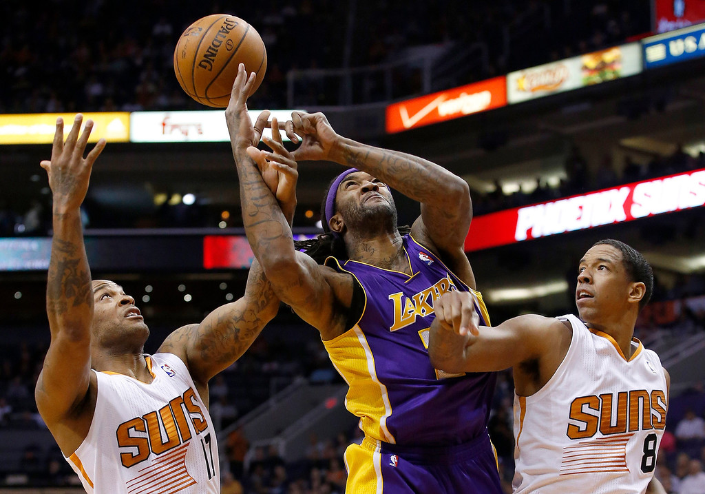 . Los Angeles Lakers\' Jordan Hill, middle, loses the ball as Phoenix Suns\' P.J. Tucker, left, tips it away while Suns\' Channing Frye (8) defends during the first half of an NBA basketball game Wednesday, Jan. 15, 2014, in Phoenix. (AP Photo/Ross D. Franklin)