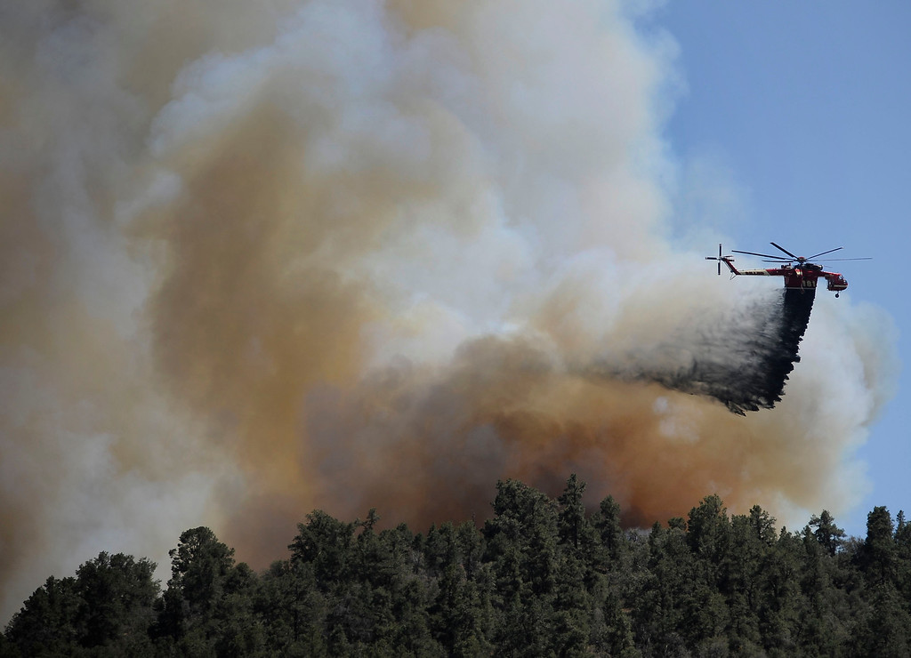 . Helicopters make water drops as firefighters battle a 3,000 plus acre brush fire that started up in Frazier Park  Wednesday. The fire  started along Frazier Mountain Rd about 1 mile west of the 5 freeway.  As of 6:00 pm the fire is 10 percent contain and no homes damage at this time. Photo by Gene Blevins/LA Daily News