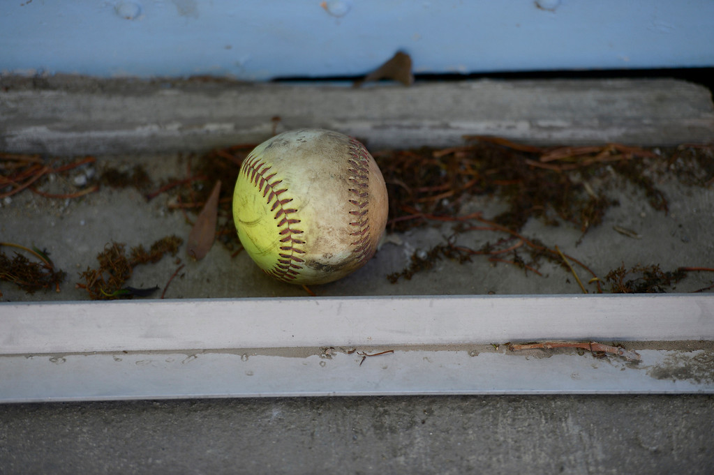 . An old softball sits near a dugout. A lawsuit is being filed over the Sylmar baseball field, which is accused of being mismanaged by the operators. Lawsuit alleges that the grounds have been neglected. Sylmar, CA. February 1, 2014 (Photo by John McCoy / Los Angeles Daily News)