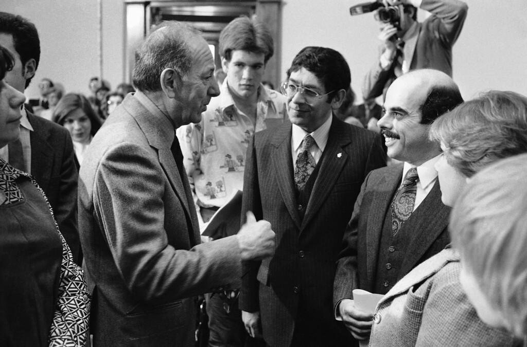 . Actor Jack Klugman, left, chats with Rep. Theodore Weiss, D-N.Y., center, and Rep. Henry Waxman, D-Calif., before testifying before the House Subcommittee on Health and Environment, Monday, March 9, 1981,Washington, D.C. The subcommittee was holding hearings on drug abuse. (AP Photo/John Duricka)