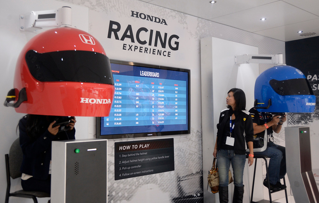 . Nov 22,2013 Los Angeles CA. The Honda racing experience displays during the 2nd media day at the Los Angeles Auto Show.The show opens today Friday and runs through Dec 1st. Photo by Gene Blevins/LA Daily News