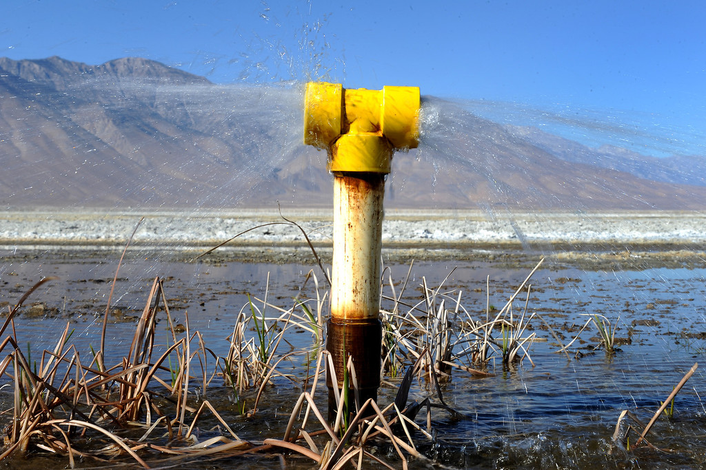 . Water sprays from a pipe at Owens Lake as part of a refilling project. (Photo by Michael Owen Baker/L.A. Daily News)