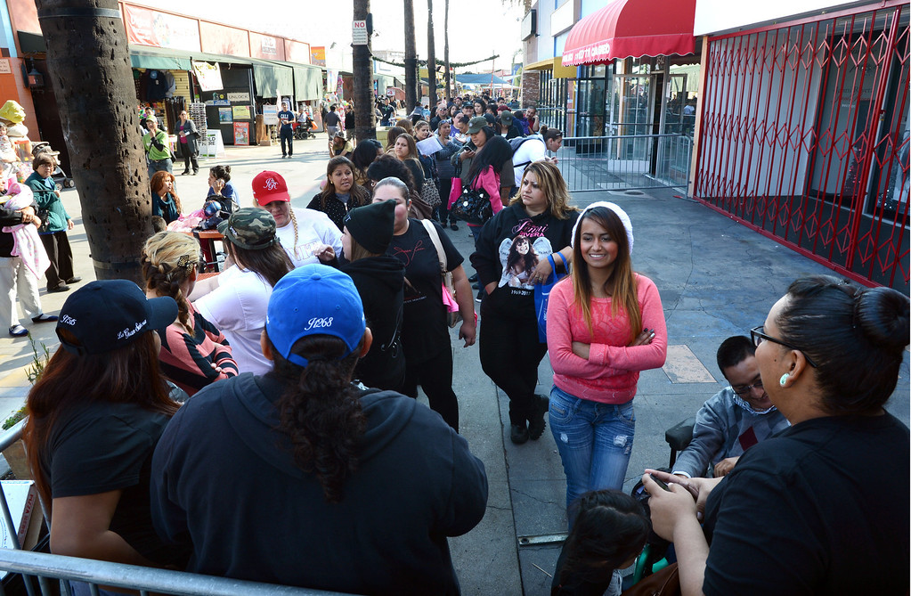 . Dec. 9 marks the one year anniversary of the death of singer Jenni Rivera. Fans line up outside the Jenni Rivera Boutique in Panorama City,  for the release of her new live album, which was recorder just before her death after her plane crashed in Mexico.  Panorama City Calif., December 3, 2013.   (Photo by Stephen Carr / Daily Breeze)