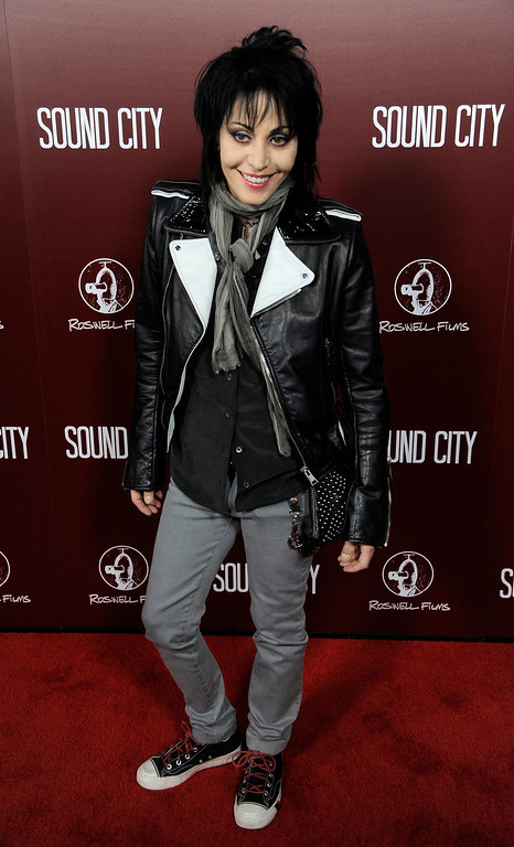 ". Singer Joan Jett poses at the premiere of the documentary film ""Sound City\""  on Thursday, Jan. 31, 2013 in Los Angeles. (Photo by Chris Pizzello/Invision/AP Images)"