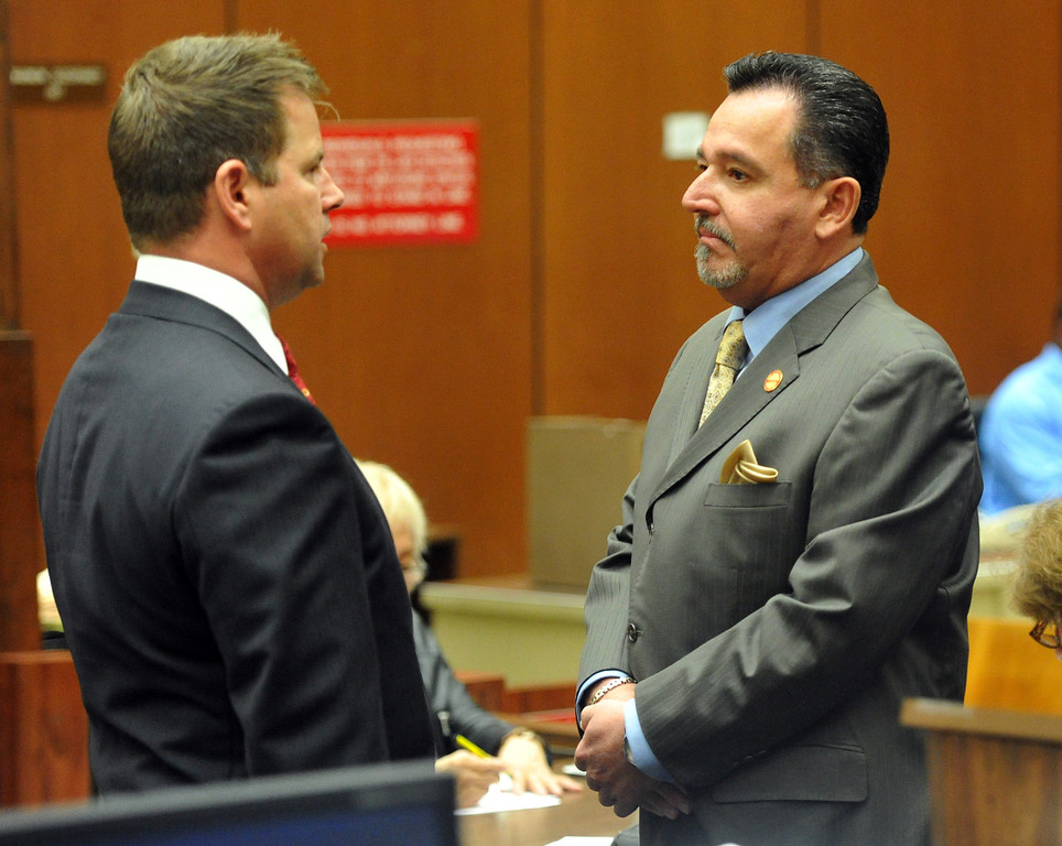 . Irwindale City Councilman Mark Breceda, right, who has been charged with embezzlement, misappropriation of public funds and conflict of interest with three other defendants, talks with his attorney Anthony Falangetti, left, as they appear in court to postpone their arraignment at the Clara Shortridge Foltz Criminal Justice Center in Los Angeles on Wednesday January 29, 2014. They will next appear on February 27th. (Staff Photo by Keith Durflinger/San Gabriel Valley Tribune)