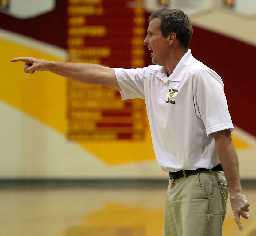 . La Canada head coach Tom Hofman reacts in the fourth quarter as they defeated La Salle 73-62 for coach Hofman\'s 600th win during a prep basketball game at La Canada High School in La Canada, Calif., on Friday, Jan. 10, 2014. Hofman record is 600 wins and 186 losses since becoming varsity head coach in the 1986-87 season. (Keith Birmingham Pasadena Star-News)