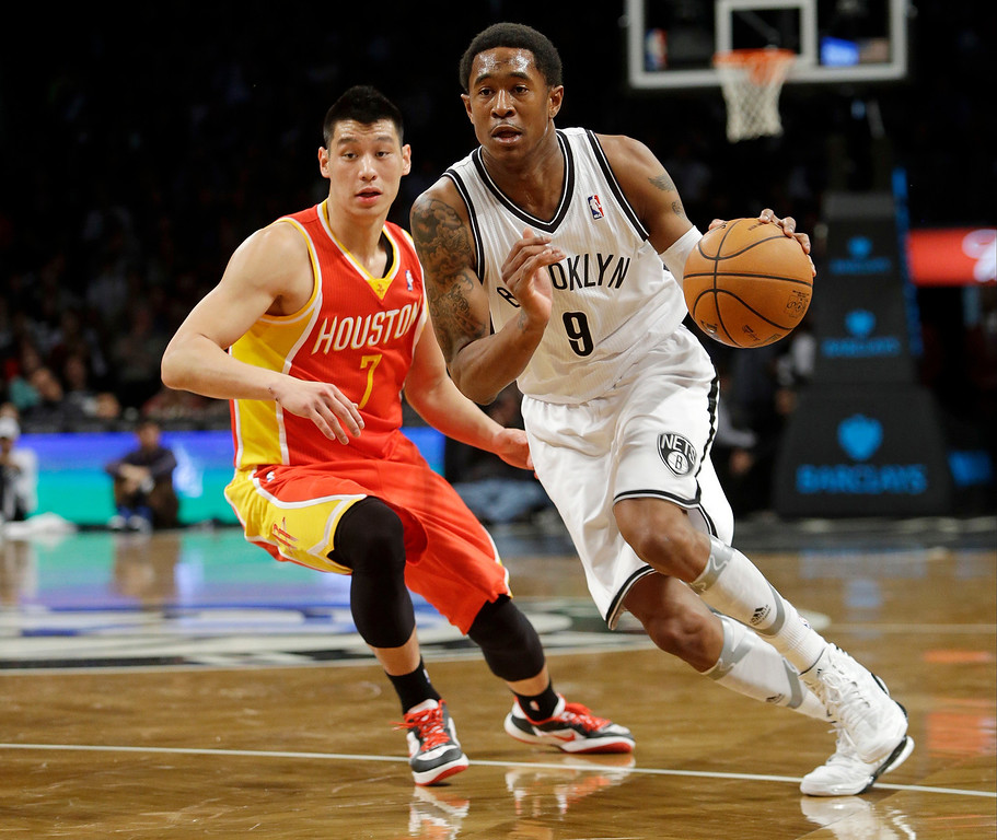 . Brooklyn Nets\' MarShon Brooks drives past Houston Rockets\' Jeremy Lin (7) during the first half of an NBA basketball game Friday, Feb. 22, 2013, in New York.  (AP Photo/Frank Franklin II)