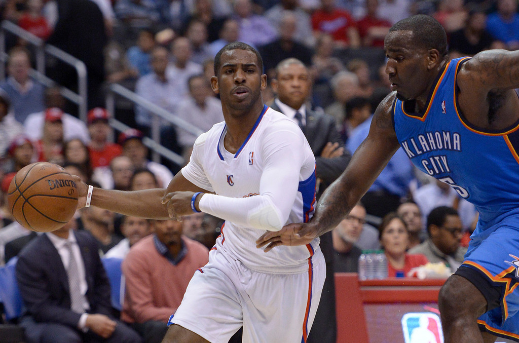 . Clippers#3 Chris Paul gets fouled by Thunder#5 Kendrick Perkins in the first quarter, and then Perkins was called for a technical for his reaction. The Los Angeles Clippers played the Oklahoma City Thunder in a regular season game at Staples Center in Los Angeles, CA. 4/9/2014(Photo by John McCoy / Los Angeles Daily News)