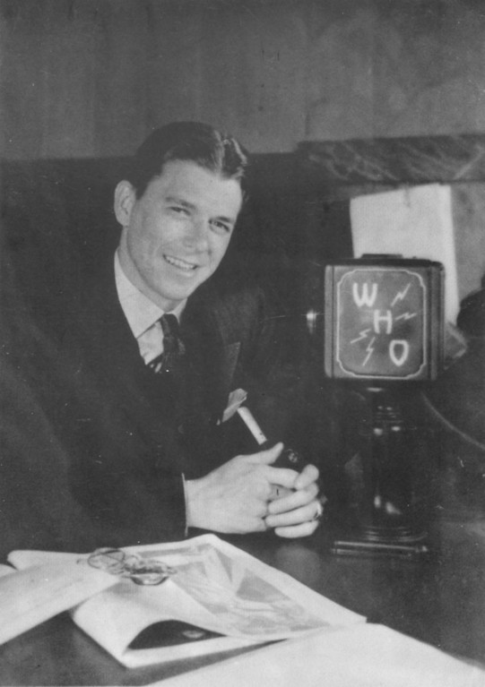 """. \""""Ronald \""""Dutch\"""" Reagan poses for a photo at WHO radio in Des Moines, IA, in this mid-1930\'s General Mills Archives photo. In 1937, Reagan was doing play-by-play for WHO radio off telegraph reports and won a Wheaties-sponsored, expense-paid trip to cover the Chicago Cubs training camp in California. While in California, Reagan took a screen test that led to his movie career. (AP Photo/General Mills Archives)"""