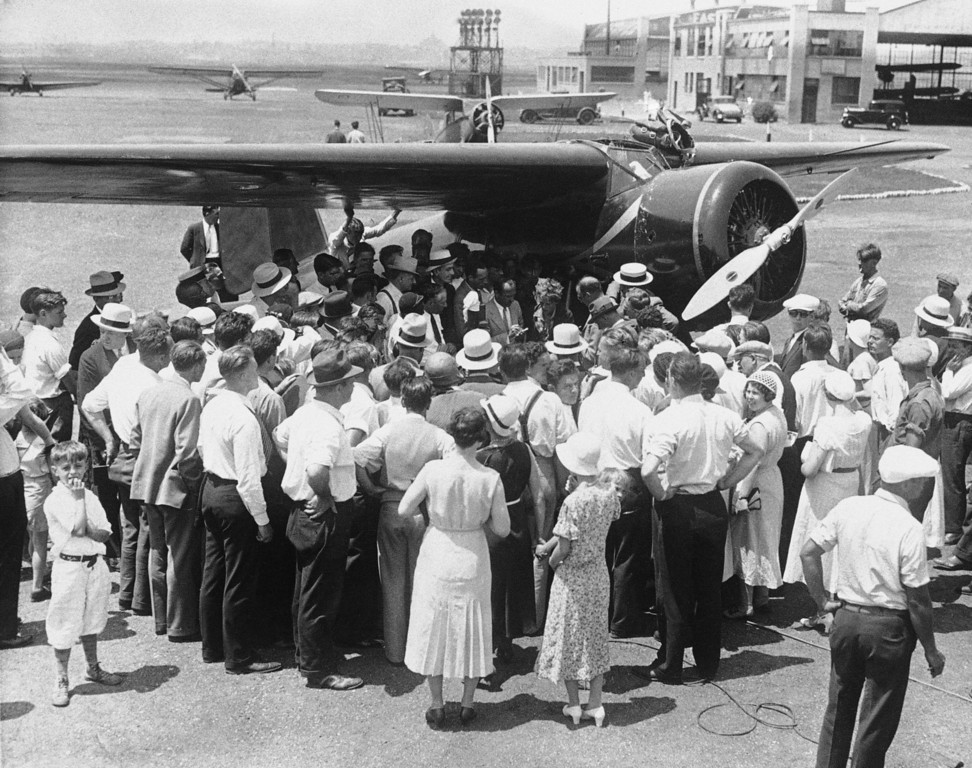 . A view of the crowd surrounding Mrs. Amelia Earhart Putnam and her plane immediately after the transatlantic flier landed at the Newark, N.J. Airport to establish a new women\'s transcontinental flight record, July 13, 1932. Mrs. Putnam bettered the previous mark held by Miss Ruth Nichols, by almost 10 hours. (AP Photo)