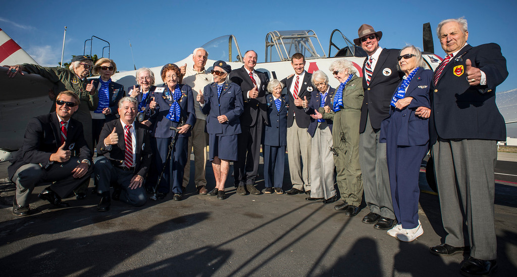 . Former WASPs, all in their 90\'s pose with members of the Condron Squadron at Van Nuys airport Tuesday, December 30, 2013.  The Condor Squadron at the Van Nuys airport hosted the former WASP pilots who are in town to represent WASPS on a tournament of Roses float.  (Photo by David Crane/Los Angeles Daily News)