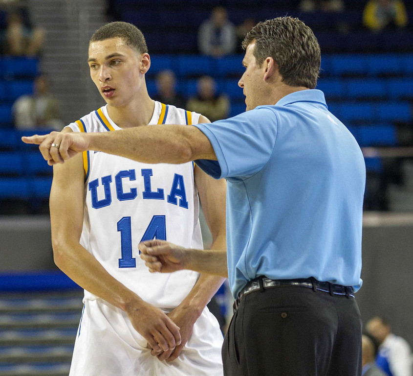. UCLA\'s head coach Steve Alford talks with his player Zach LaVine #14 against Cal State San Bernardino in the second half of their basketball game at UCLA\'s Pauley Pavilion during an NCAA college exhibition basketball game, Wednesday, Oct. 30, 2013 in Los Angeles. UCLA won 96-66. (AP Photo/Ringo H.W. Chiu)