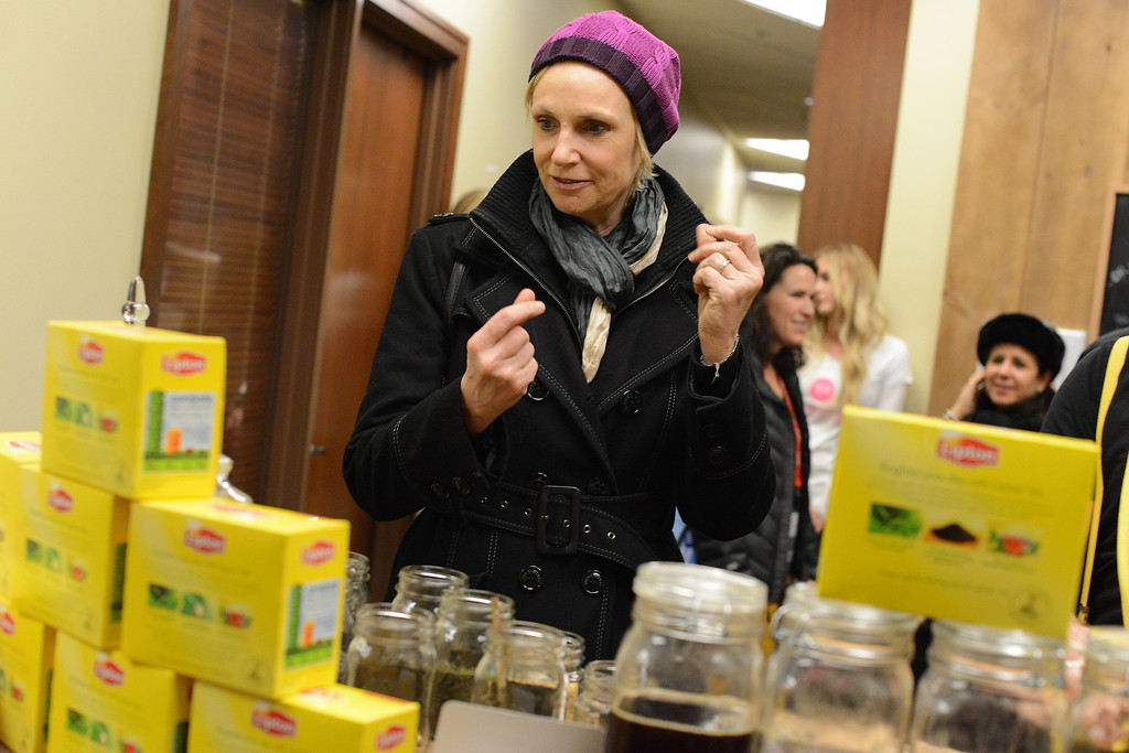". IMAGE DISTRIBUTED FOR LIPTON: Actress Jane Lynch snaps into action customizing her own tea blend, which she dubbed ""Kick of Spice\"" at the Lipton Uplift Lounge Tea Bar during Sundance on Sunday Jan. 20, 2013, in Park City, UT.(Photo by Jordan Strauss/Invision for Lipton/AP Images)"