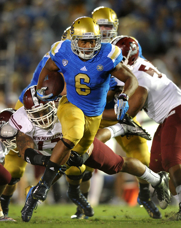. UCLA RB Jordon James runs through the New Mexico State secondary, Saturday, September 21, 2013, at the Rose Bowl. (Photo by Michael Owen Baker/L.A. Daily News)
