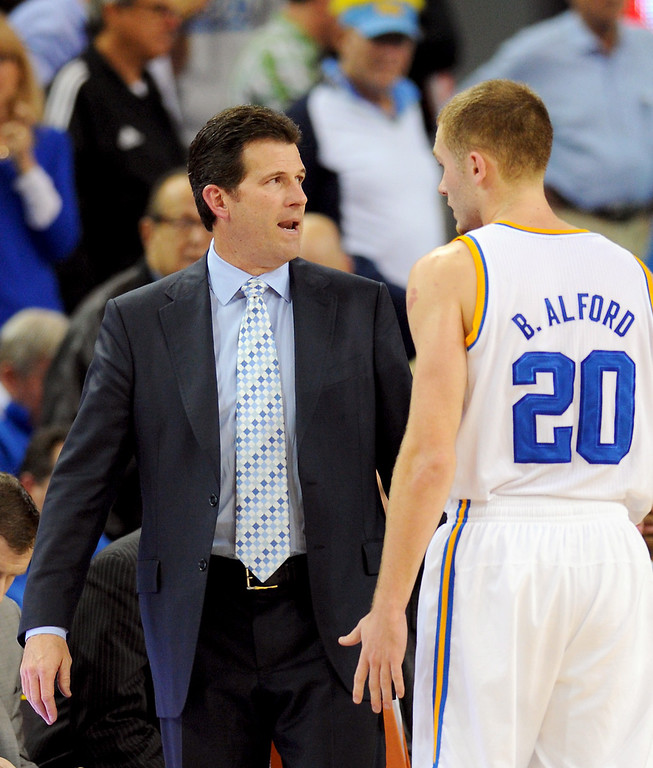 . UCLA\'s head coach Steve Alford has words with his son Bryce Alford, Thursday, January 9, 2014, at Pauley Pavilion. (Photo by Michael Owen Baker/L.A. Daily News)
