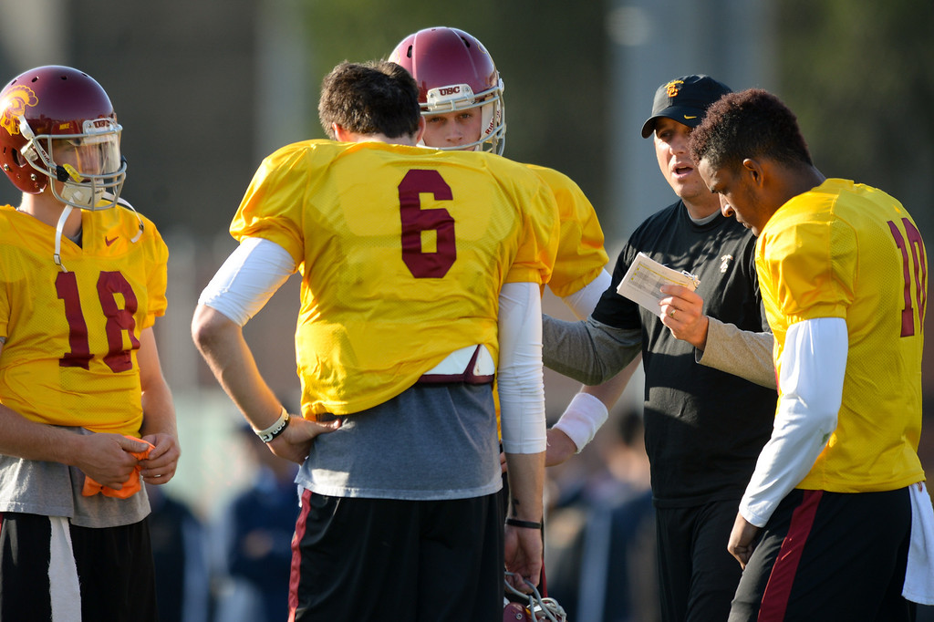 . USC quarterbacks coach Clay Helton talks with the quarterbacks at practice, Thursday, March 27, 2014, at USC. (Photo by Michael Owen Baker/L.A. Daily News)