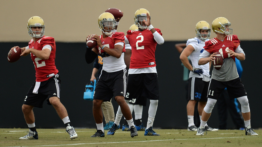 . UCLA quarterbacks during football practice at Spaulding Field on the UCLA campus Thursday, April 17, 2014. (Photo by Hans Gutknecht/Los Angeles Daily News)