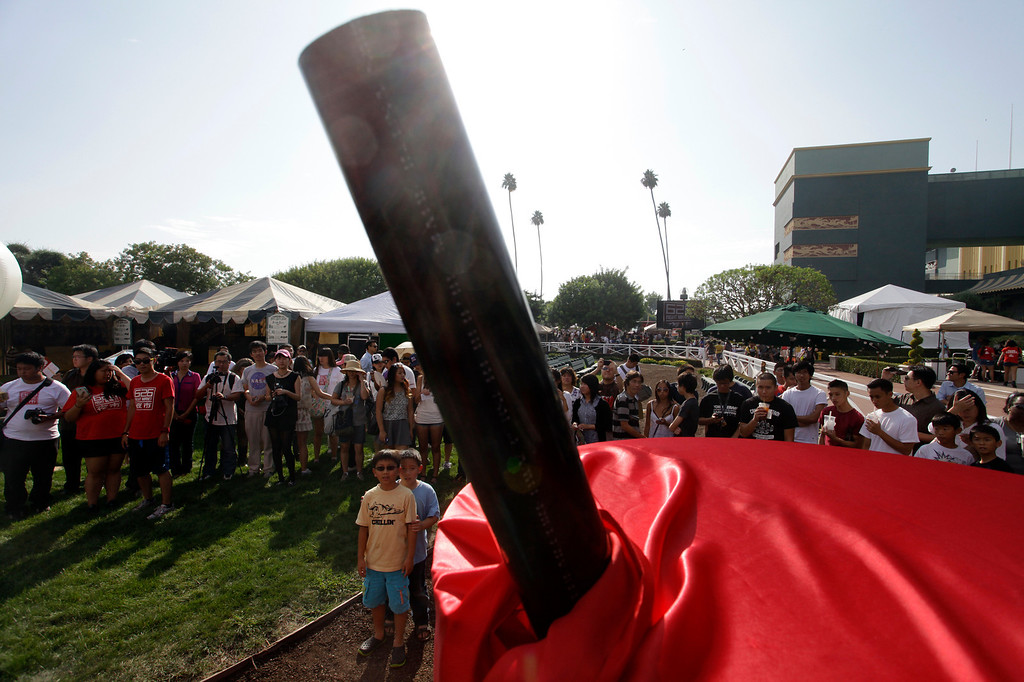 . A crowd gathers for the unveiling of the world\'s largest boba cup during the 626 night market at Santa Anita Park in Arcadia, Saturday August 3, 2013. (SGVN/Correspondent Photo by Ron Fu/SVCITY)