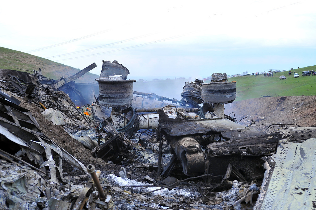 . The remains of a crashed US KC-135 Stratotanker plane are seen on a hill near the villages of Chorgolo and Cholok-Aryk, 180 km from the Kyrgyzstan?s capital Bishkek, on May 3, 2013. A refuelling plane from the US Manas airbase in Kyrgyzstan crashed after taking off, the emergency situations ministry told AFP on Friday. The fate of the crew of a US tanker plane that crashed in northern Kyrgyzstan on Friday is unknown but emergency services are on the scene, the aircraft\'s US air base said. AFP PHOTO/ STRINGER        (Photo credit should read STRINGER/AFP/Getty Images)
